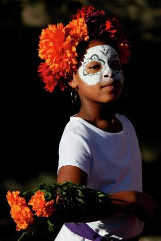 METRO - Ashley Moore, 9, walks with the Austin Samba School during the Dia de los Muertos celebration at La Villita on Sunday, Nov. 1, 2009. LISA KRANTZ/lkrantz@express-news.net Photo: LISA KRANTZ, SAN ANTONIO EXPRESS-NEWS / lkrantz@express-news.net