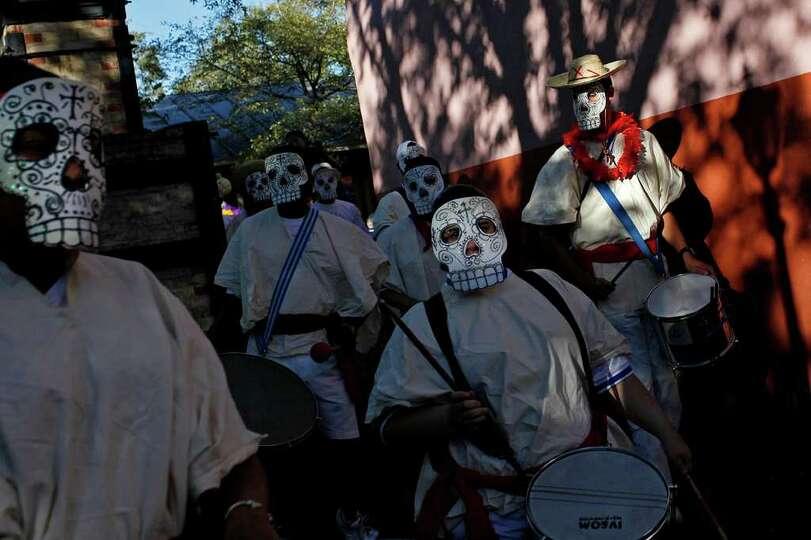 Drummers with Austin Samba School drum as they parade around La Villita during the Dia de los Muerto