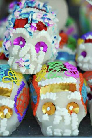 Sugar skulls are some of the items sold outside the old municipal cementary in Nuevo Laredo in observance of dia de los muertos. Photo: ULYSSES ROMERO / LAREDO MORNING TIMES