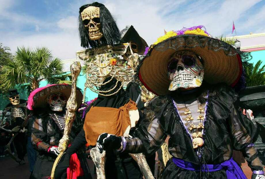 "Beatrice Guerra (right) and other members of Las Monas Drum & Dance Group perform during the Museo Alameda's ""Dia de los Muertos: Bodas Negras, A Celebration of Lost Love"" event held Sunday Nov. 2, 2008 in El Mercado.  Photo: EDWARD A. ORNELAS, SAN ANTONIO EXPRESS-NEWS / eornelas@express-news.net"