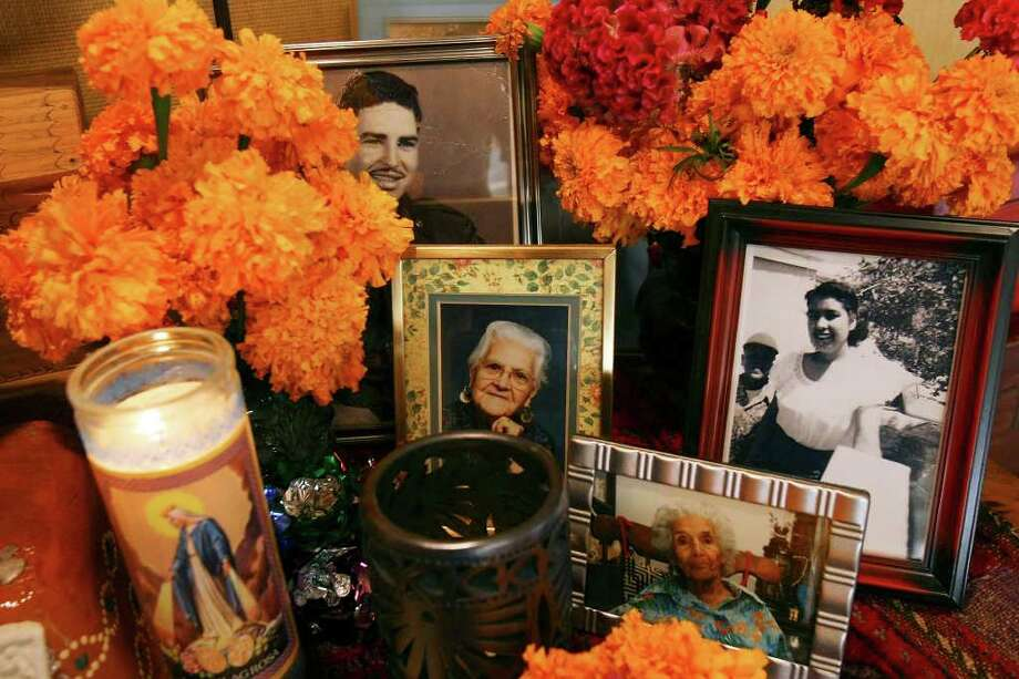Detail of family photos in the Dia de los Muertos altar at Jon Hinojosa's home Friday Oct. 17, 2008. (PHOTO BY EDWARD A. ORNELAS/eornelas@express-news.net) Photo: EDWARD A. ORNELAS, SAN ANTONIO EXPRESS-NEWS / eornelas@express-news.net