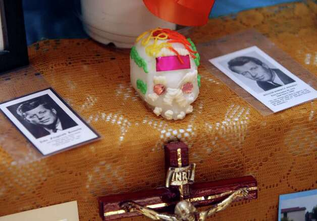 METRO -- Images of John and Robert Kennedy on the El Dia de los Muertos altar built by the staff of the Mexican-American Cultural Center Wednesday October 31, 2007. Photo: Robert McLeroy, San Antonio Express-News / San Antonio Express-News