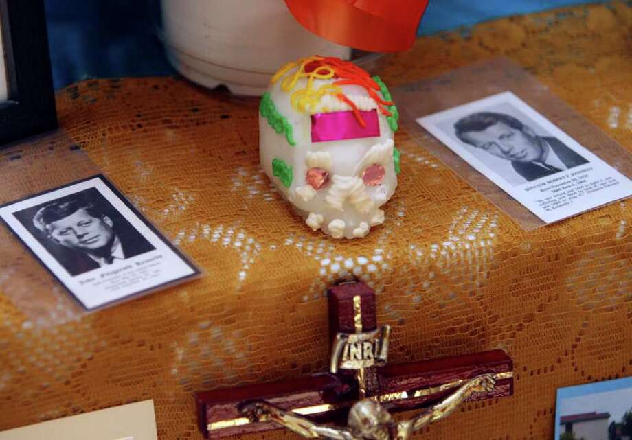 Images of John and Robert Kennedy on the El Dia de los Muertos altar built by the staff of the Mexican-American Cultural Center Wednesday October 31, 2007. Photo: Robert McLeroy, San Antonio Express-News / San Antonio Express-News