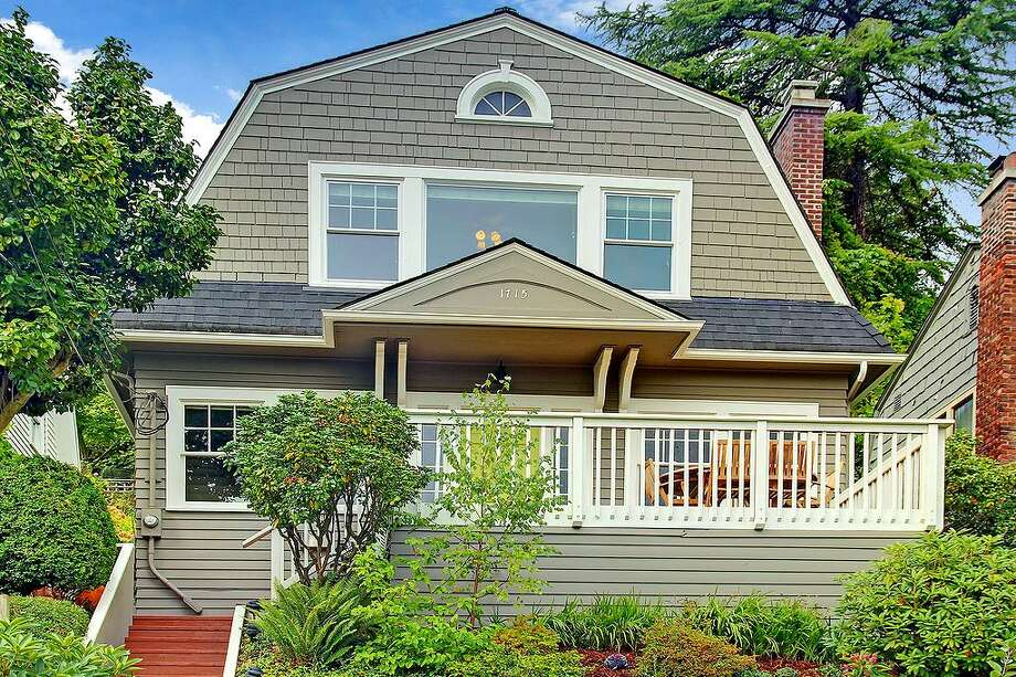 Madrona is one of Seattle's most-desirable neighborhoods, with stunning homes on tree-lined streets close to the action of Capitol Hill and downtown. Here are four homes on the market there now for $800,000 to $850,000, starting with this Colonial at 1715 37th Ave. The 2,220-square-foot house has three bedrooms, 2.25 bathrooms, arched doorways, built-in shelves, wide moldings, a brick fireplace, French doors, a finished basement, front and back porches and a view of Lake Washington. It sits on a 3,710-square-foot lot and is listed for $815,000. Photo: Findwell