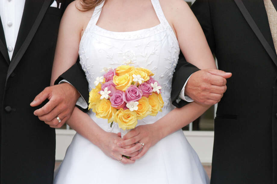 """""""Stepparents shouldn?t necessarily be treated exactly the same as the parents, but they should be treated with respect and not discounted?  ?Lisa Light, Wedding Planner (Photo: (c) iStockphoto/Jeffrey Hecker)"""