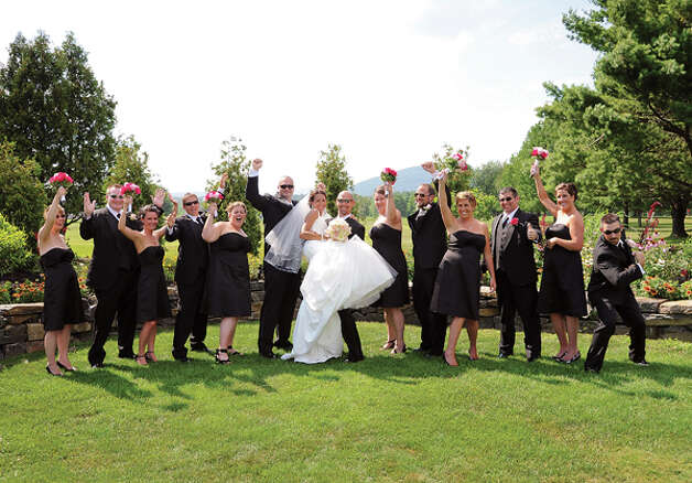 Jennifer and Eric Lewicki chose a black and white theme for their wedding, dressing the groomsmen in black tuxedos and the bridal party in black gowns. (Photo by Jessica Painter)