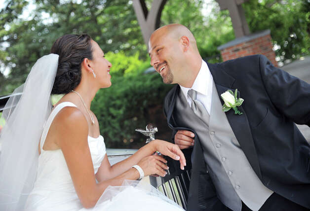 Jennifer and Eric Lewicki were married at Our Lady of the Annunciation Roman Catholic Church on July 23, 2011. (Photo by Jessica Painter)