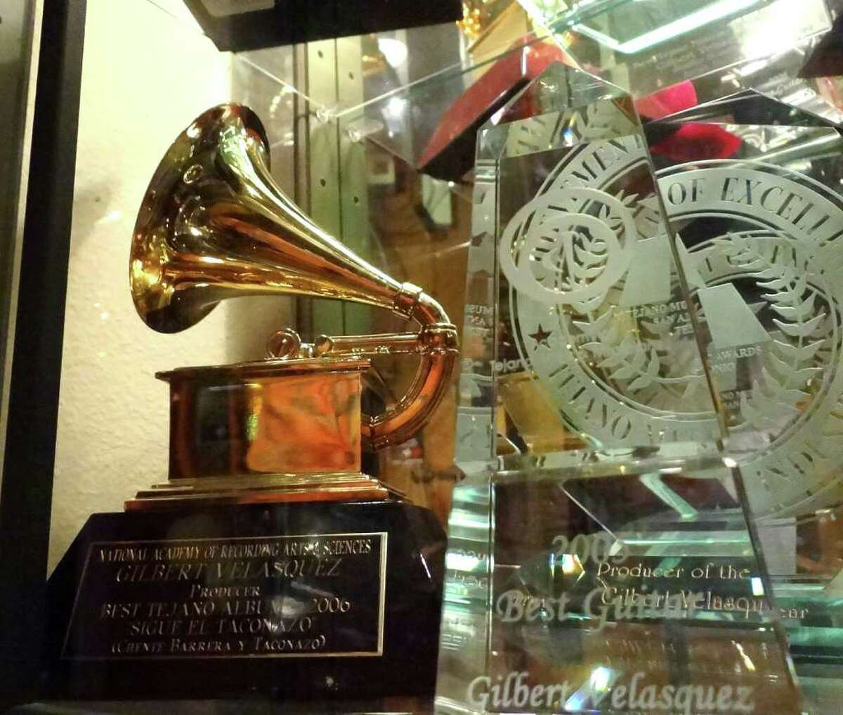 HONORS: The trophy case in Velasquez's studio holds many awards, including one of his Grammys.