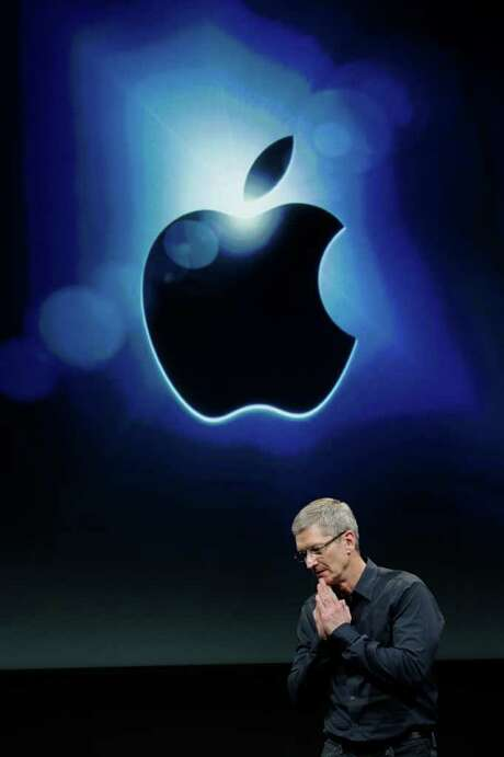 FILE - In this Oct. 4, 2011 file photo, Apple CEO Tim Cook gestures during the introduction of the iPhone 4S, at Apple headquarters in Cupertino, Calif. Apple Inc., reports quarterly financial results Tuesday, Oct. 18, 2011, after the market close. (AP Photo/Paul Sakuma, File) Photo: Paul Sakuma / AP