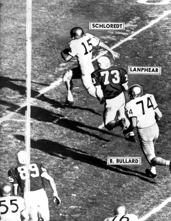UW quarterback Bob Schloredt on a keeper play that setup the first Husky touchdown in the 1960 Rose Bowl. Behind him is UW's Barry Bullard. Photo: Seattlepi.com File