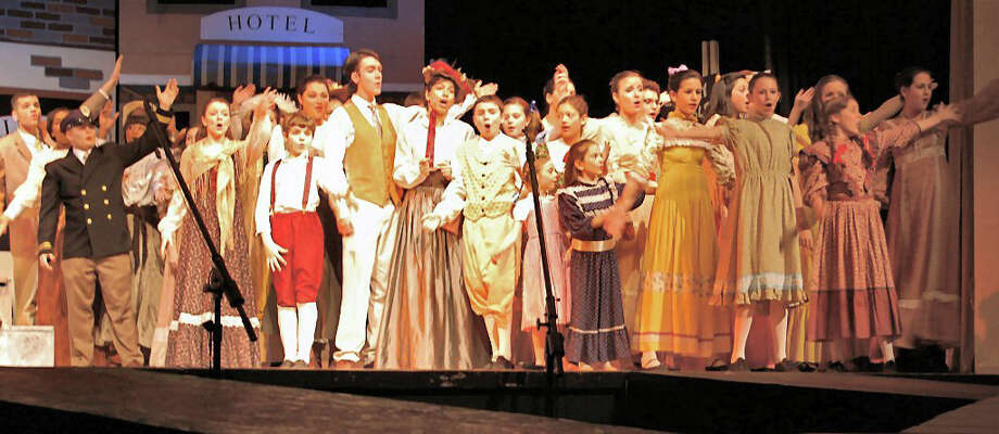 """Brien McMahon High School Drama Club members, depicted here in last year's """"Music Man"""" performance, will not be able to put on a fall musical without help from the community. Photo: Contributed Photo"""