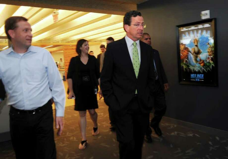 Blue Sky Studios Chief Operating Officer Brian Keane, left, shows Gov. Dannel P. Malloy around the company's Greenwich studios during Malloy's jobs tour on June 27, 2011. Photo: Helen Neafsey, Greenwich Time / Greenwich Time