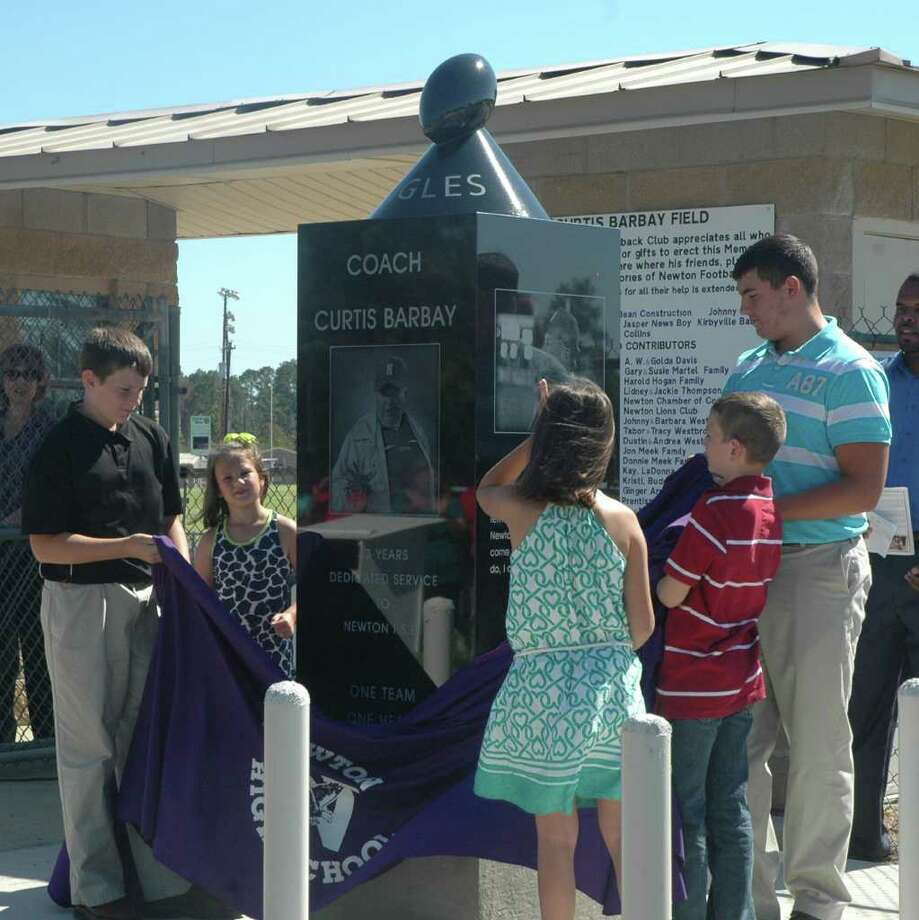 Curtis Barbay's grandchildren unveil the monument during ceremony Photo: Jimmy Galvan