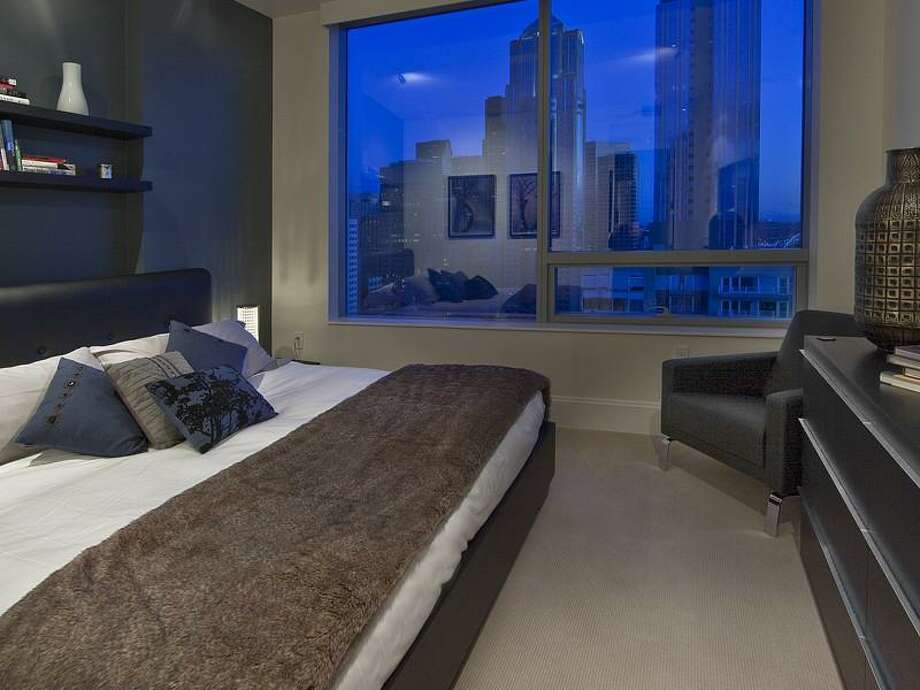 Bedroom of 1521 2nd Ave., unit 1202. The 1,729-square-foot condo, in one of Seattle's most-exclusive towers, has two bedrooms and 1.5 bathrooms, with views of Elliott Bay and downtown, and is two blocks from Pike Place Market. Photo: Realogics Sotheby's International Realty