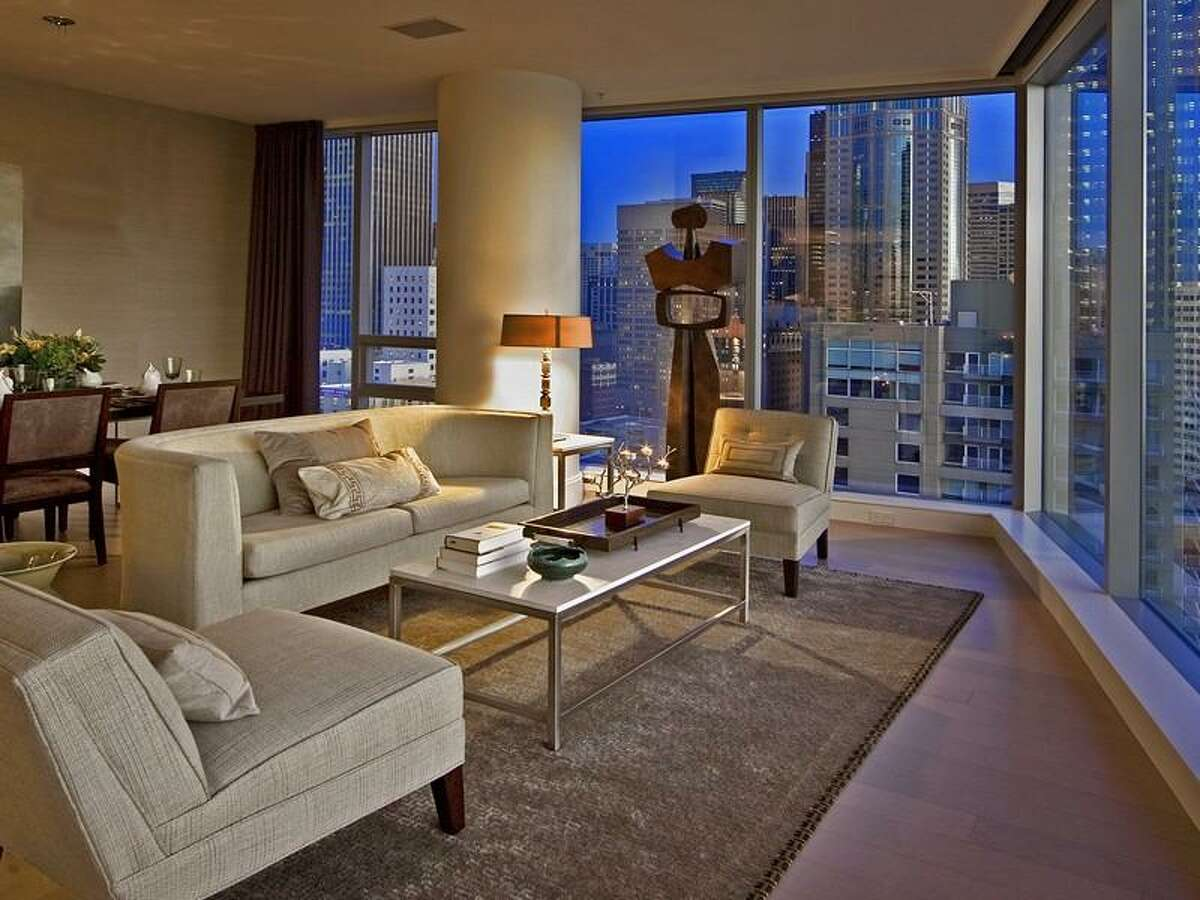 Living room of 1521 2nd Ave., unit 1202. The 1,729-square-foot condo, in one of Seattle's most-exclusive towers, has two bedrooms and 1.5 bathrooms, with views of Elliott Bay and downtown, and is two blocks from Pike Place Market.