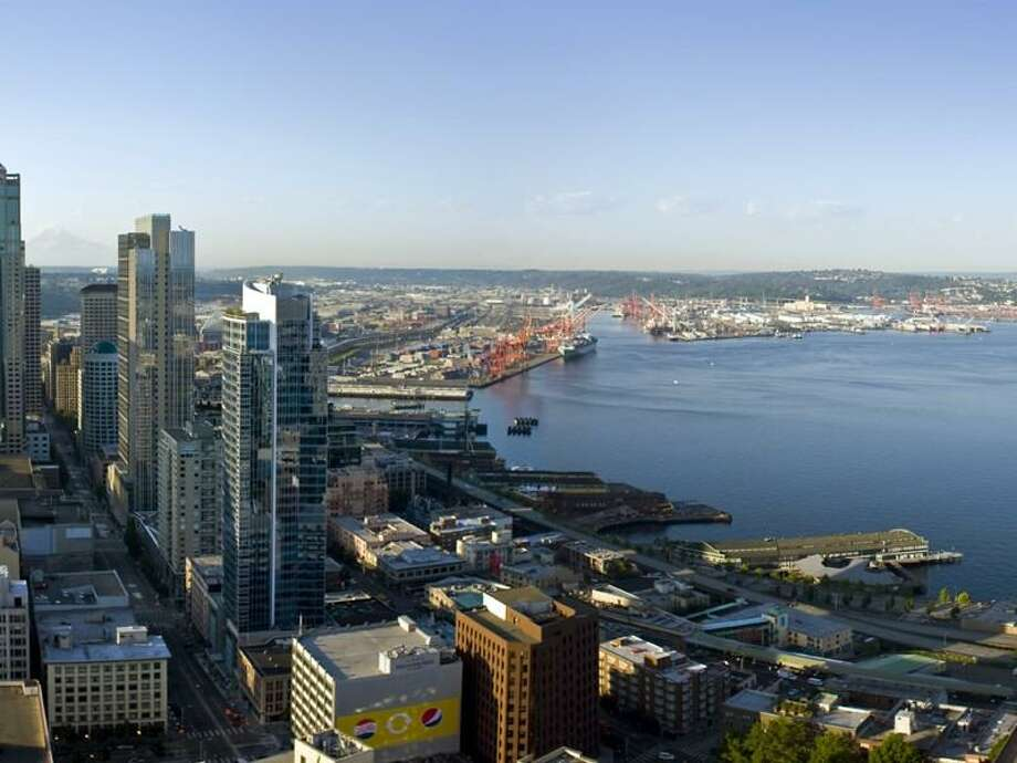 View from 1521 2nd Ave., unit 1202. The 1,729-square-foot condo, in one of Seattle's most-exclusive towers, has two bedrooms and 1.5 bathrooms, with views of Elliott Bay and downtown, and is two blocks from Pike Place Market. Photo: Realogics Sotheby's International Realty