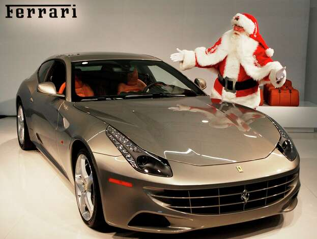 "This 2012 Ferrari FF, which tops out above 200 mph, has four-wheel drive and boasts the color ""grigio caldo,"" can be yours for a mere $395,000 — but it comes with a set of luggage. LM OTERO/ASSOCIATED PRESS Photo: LM OTERO/ASSOCIATED PRESS"