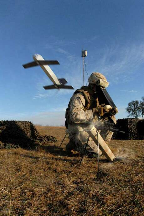 "AEROVIRONMENT : AFP/GETTY  SMALL AND DEADLY: A U.S. soldier launches a ""Switchblade"" drone, which have been used against militants in Afghanistan. Photo: HO / AFP"