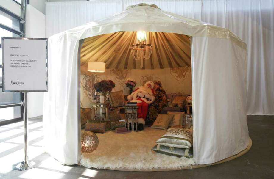 "L.M. OTERO: ASSOCIATED PRESS YURT FOR YOU: Sitting inside a plush Rainier yurt, Brady White portrays Santa Claus as model Brittany Leigh whispers to him inside the $75,000 ""Dream Folly""backyard getaway. Photo: LM Otero / AP"