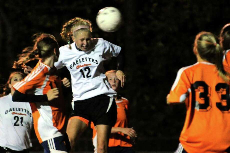 Shelton's #12 Megan Burke head the ball in for a goal, during girls soccer action against Lyman Hall in Shelton, Conn. on Tuesday October 18, 2011. Photo: Christian Abraham / Connecticut Post