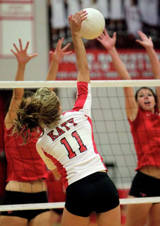 Katy's Keely Kainer (11) goes up for a big hit against Memorial. Photo: Bob Levey, Houston Chronicle / ©2011 Bob Levey