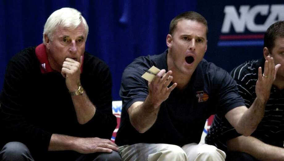 Texas Tech coach Bob Knight, left, looks over the court as his son and assistant coach Pat Knight yells at a referee during their first round NCAA Tournament game against UCLA at the McKale Center in Tucson, Ariz., Thursday, March 17, 2005. (AP Photo/Charles Rex Arbogast) Photo: CHARLES REX ARBOGAST, STF / Beaumont