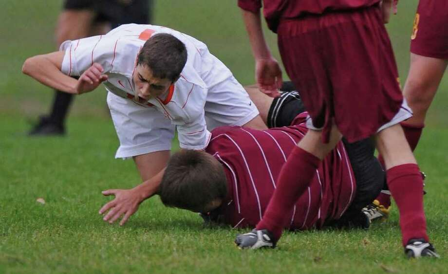 Bethlehem's Zach Stryker, left, collides with Colonie goalkeeper Todd Lawson, right, after he gets the ball during the second half of their  2-1 win over Colonie on Tuesday Oct. 18, 2011 in Delmar, NY. Play was stopped and Stryker was taken off the field on a stretcher by emergency workers called to the field.  (Philip Kamrass / Times Union ) j Photo: Philip Kamrass / 00014999A