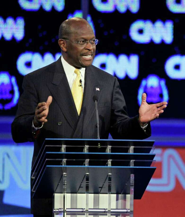 Republican presidential candidate businessman Herman Cain speaks during a Republican presidential debate Tuesday, Oct. 18, 2011, in Las Vegas.  (AP Photo/Chris Carlson) Photo: Chris Carlson