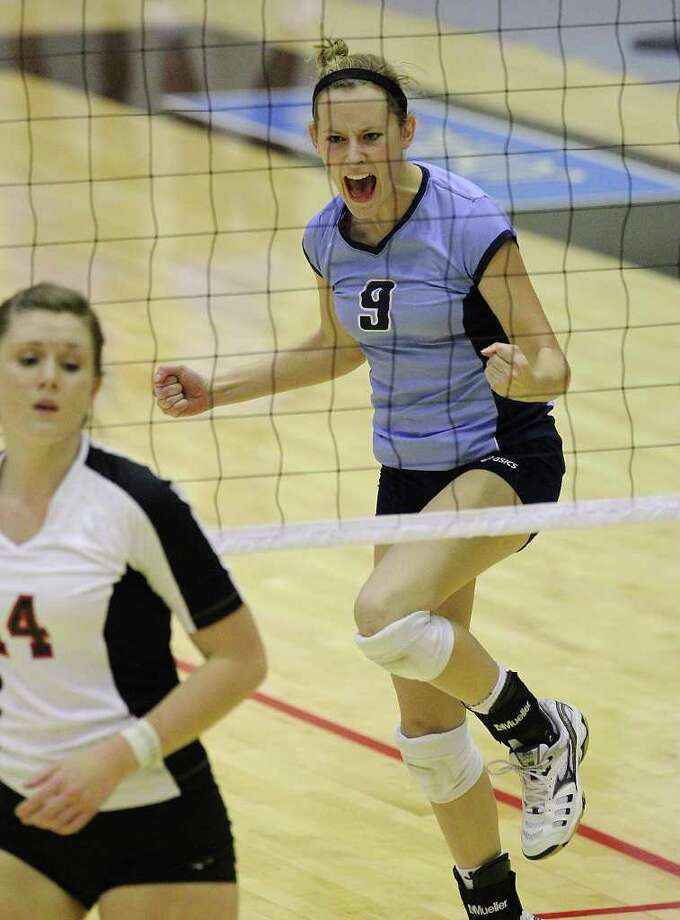 Johnson's Kassie Freitag (09) reacts after winning a point against Churchill's Audrey Sanders (14) in volleyball at Littleton Gym on Tuesday, Oct. 18, 2011. Johnson defeated Churchill in three straight games.  Kin Man Hui/kmhui@express-news.net Photo: Kin Man Hui, ~ / San Antonio Express-News