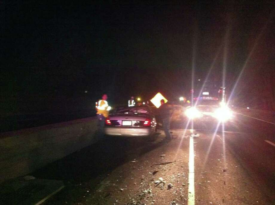A state trooper was hit at 10:33 p.m. Tuesday night, Oct. 18, 2011, while directing traffic around construction on the Merritt Parkway northbound in Fairfield, just past Burr Street. Photo: Tim Loh