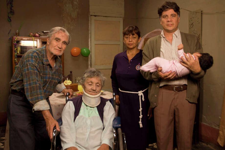 "(L-R) Carlos Gasols as Don Fico, Norma Francisca Villarreal as Rosa, Gabriela Velásquez as Sofia and Bruno Odar as Clemente in ""Octubre."""