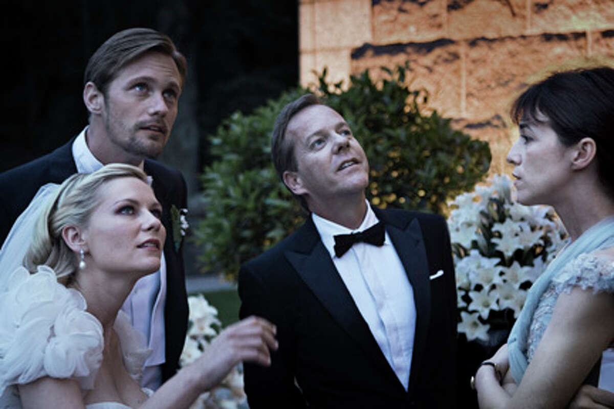 (L-R) Kirsten Dunst as Justine, Alexander Skarsgard as Michael, Kiefer Sutherland as John and Charlotte Gainsbourg as Claire in