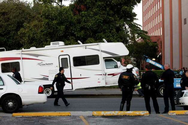 An RV used by the suspects in the break-in at the Bexar County Courthouse remains parked outside the courthouse moments before it was towed, Wednesday, Oct. 19, 2011. Photo: LISA KRANTZ, SAN ANTONIO EXPRESS-NEWS / lkrantz@express-news
