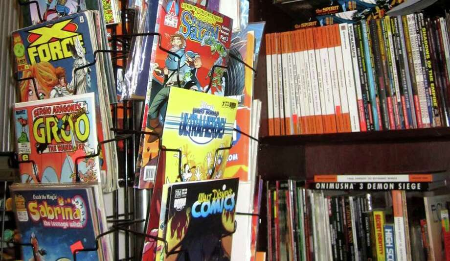 Krypto Comics is on Bank Street in New Milford. Its offerings range from comics priced five for $1 to collectibles on sale for $1,000 to $2,000. Trading cards from 1982 to 1984 are also offered in their original boxes and packs. Photo: Norm Cummings
