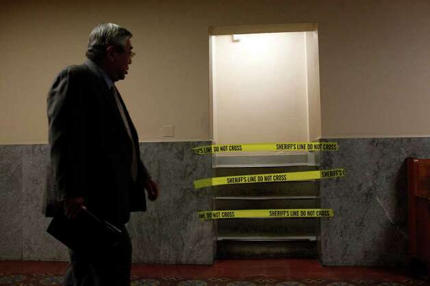 Judge Peter Sakai walks by a taped off stairway that goes from the fourth to the fifth floor of the Bexar County Courthouse after the investigation of the alleged early morning break-in at the courthouse in San Antonio on Wednesday, Oct. 19, 2011. LISA KRANTZ/lkrantz@express-news.net Photo: LISA KRANTZ, SAN ANTONIO EXPRESS-NEWS / lkrantz@express-news