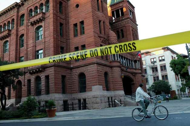 Crime tape remains after the investigation of an alleged break-in at the Bexar County Courthouse in San Antonio on Wednesday, Oct. 19, 2011. LISA KRANTZ/lkrantz@express-news.net Photo: LISA KRANTZ, SAN ANTONIO EXPRESS-NEWS / lkrantz@express-news