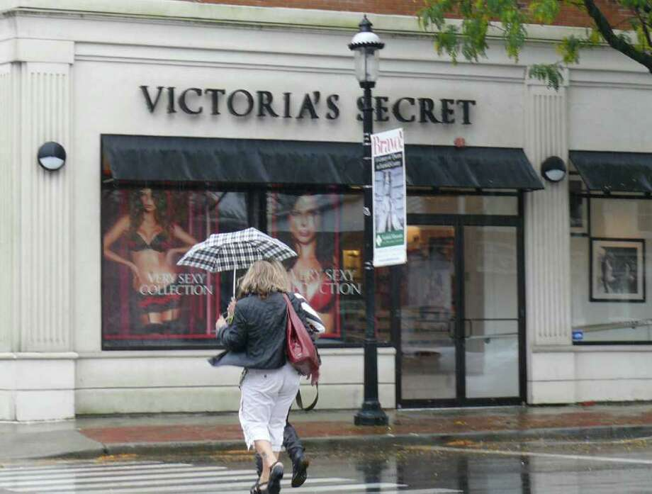 Umbrellas were a requirement Wednesday as storm moved through the area. Photo: Genevieve Reilly / Fairfield Citizen