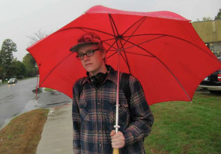 Westporter Jamie Morgan, 18, a student at Norwalk Community College, braves the elements Wednesday while waiting for a bus to school in front of Anthropologie on Post Road East. Photo: Kirk Lang / Westport News freelance