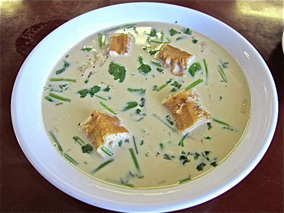 Salty soy milk is a traditional Chinese breakfast soup that includes chive, cilantro and pieces of dried shrimp. Photo: Alison Cook