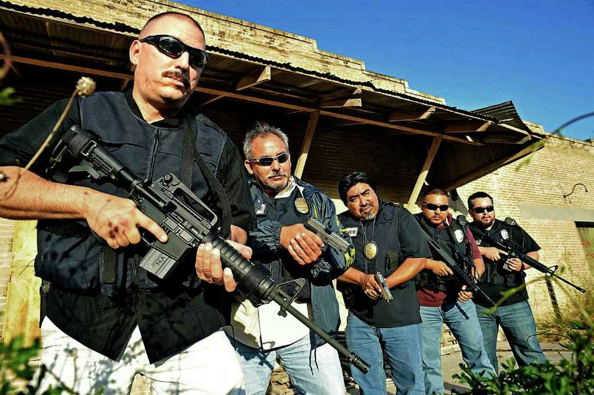 060411 A&E Bordertown-Laredo, Texas. The elite narcotics unit fighting on the front lines against an endless supply of drugs crossing the border from Mexico into the US through their small Texas town of Laredo. (Left to Right) Unit commander Sgt. Robert Sifuentes, Jorge Rodriguez, Ezekial Moreno, Roly and Bobby, all police officers using fake names for their safety.
