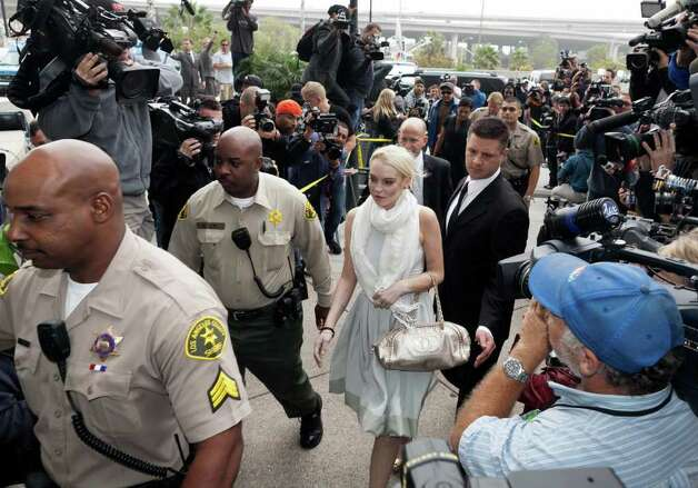 Lindsay Lohan arrives at the Los Angeles Superior Court West District Airport Courthouse Wednesday, Oct. 19, 2011, in Los Angeles. A city prosecutor will recommend Wednesday that Lohan be sent back to jail because she had been ousted from a community service assignment at a women's shelter. Photo: AP