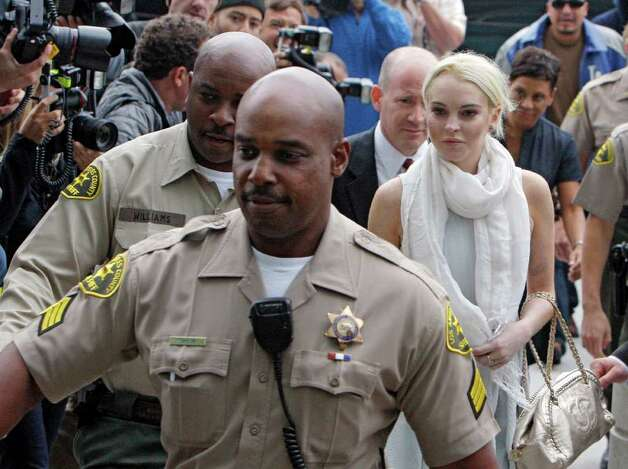 Lindsay Lohan arrives at the Los Angeles Superior Court West District Airport Courthouse Wednesday, Oct. 19, 2011, in Los Angeles. A city prosecutor will recommend Wednesday that the troubled starlet be sent back to jail because she had been ousted from a community service assignment at a women's shelter. Photo: AP