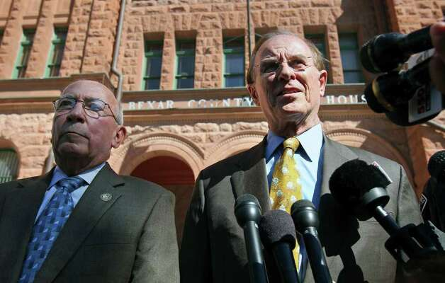 County Judge Nelson Wolff (right) speaks with media outside the courthouse with Sheriff Amadeo Ortiz concerning an overnight break-in at the Bexar County Courthouse on October 19, 2011. Photo: TOM REEL, SAN ANTONIO EXPRESS-NEWS / © 2011 San Antonio Express-News