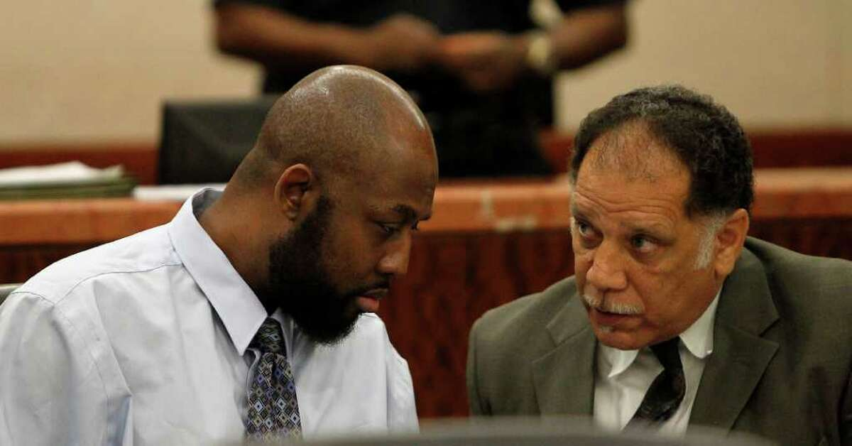 Karen Warren photos : Houston Chronicle DEFENDANT: Roderick Fountain, left, confers with his lawyer Wednesday as the 37-year-old's trial gets under way at the Harris County Criminal Courthouse. Fountain is accused of felony murder in the 2006 death of his son, Kendrick Jackson.