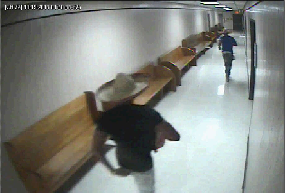 A screen grab from a surveillance shows the men who allegedly broke in to the Bexar County Courthouse wearing sombreros early Wednesday morning, October 19, 2011.  Courtesy of Bexar County.