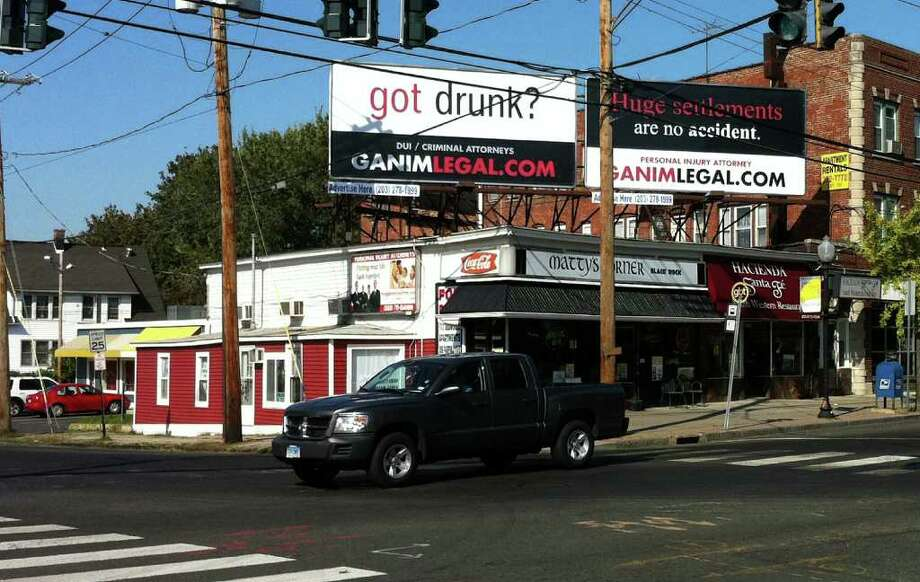 The ìGot Drunkî billboard at the corner of Fairfield Avenue and Brewster Street in Bridgeport has its share of detractors. Photo: John Burgeson