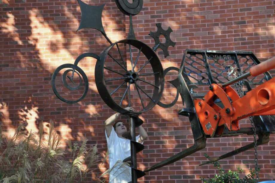 """Walter,"" a scrap-iron sculpture by Weston artist Carol Eisner, is installed next to the front entrance of Westport Public Library. The piece, named after a man who helped Eisner collect pieces of iron, was recently in an exhibit on Broadway with eight other sculptures by Eisner. Photo: Contributed Photo"