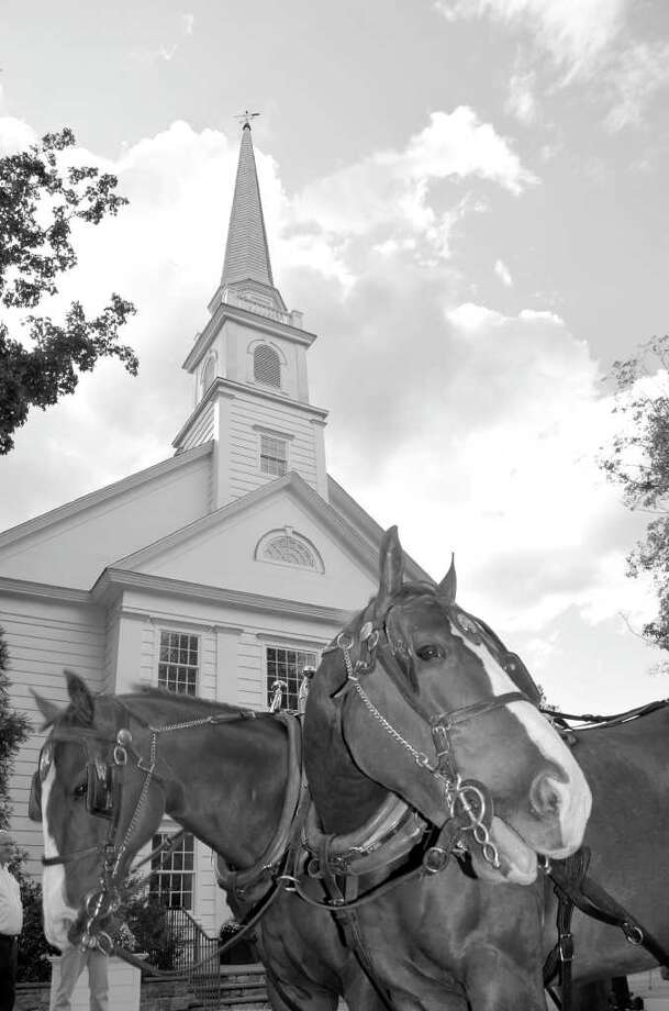 A pair of horses pose in front of Stanwich Congregational Church. They were on hand to give stagecoach rides to congregants who were celebrating the church's history. Photo: Contributed Photo