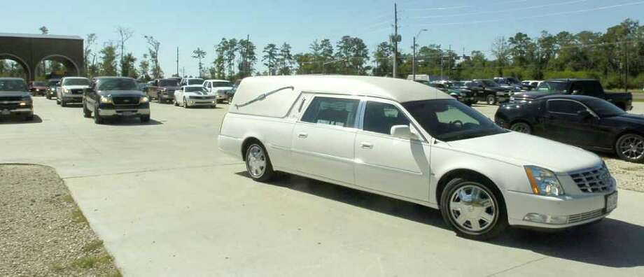 The hearse carrying the casket of Matt Thomas, leaves the Turning Point Church parking lot enroute to the cemetery Wednesday morning. The Vidor teen and varsity football player died over the weekend. The preliminary autopsy report showed no bullet or stab wounds were found on his body.   Dave Ryan/The Enterprise