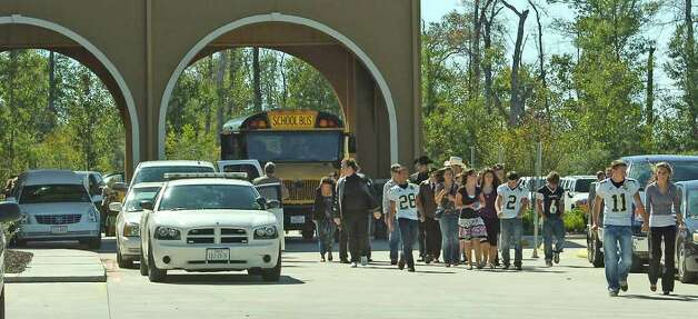 Football players, students, and friends leave the Turning Point Church after the casket was loaded into the hearse Wednesday morning. Matt Thomas, the Vidor teen and varsity football player, died over the weekend. The preliminary autopsy report showed no bullet or stab wounds were found on his body.   Dave Ryan/The Enterprise